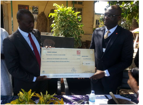 Presentation of D500,000 Cheque to The Ministry of Tourism